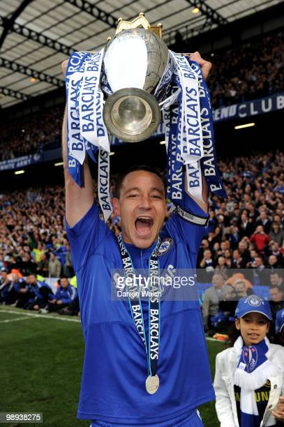 Chelsea captain John Terry celebrates with the trophy after winning the league with an 80 victory during the Barclays Premier League match between...