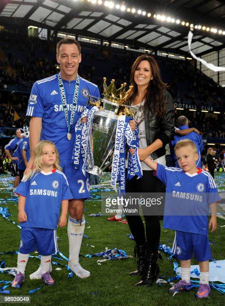 Chelsea captain John Terry his wife Toni and their children celebrate with the trophy after winning the league with an 80 victory during the Barclays...
