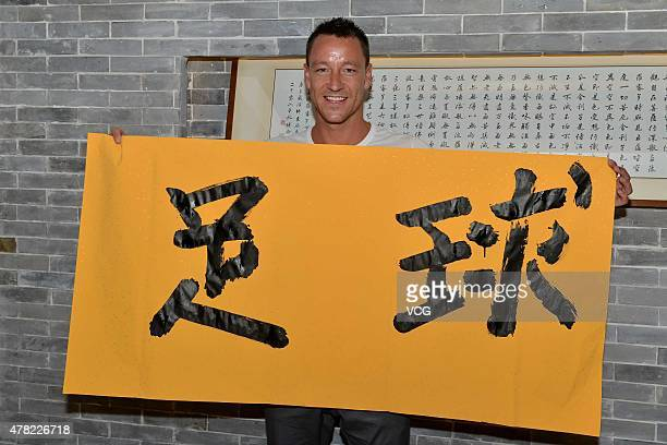 Chelsea captain John Terry shows off calligraphy at China Fan Club during his visit on June 23 2015 in Guangzhou Guangdong province of China