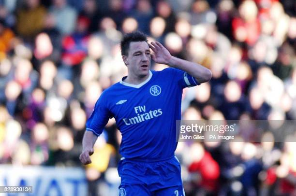 Chelsea captain John Terry silences the Scarborough crowd as he celebrates his early goal during the FA Cup 4th rd match at The McCain Stadium,...