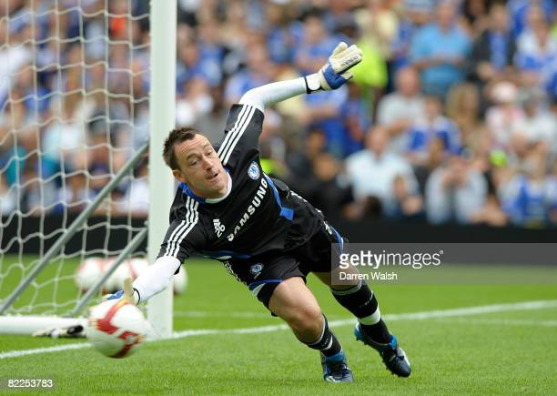 Chelsea captain John Terry tries his hand at goalkeeping during a Chelsea FC open day and training session at Stamford Bridge on August 11, 2008 in...