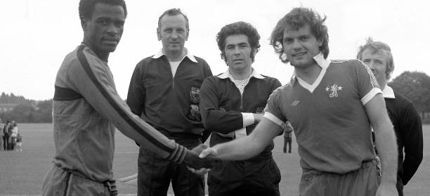 Chelsea captain Ray Wilkins shakes hands with the Malawi captain before the Pre-Season Friendly match between Chelsea and the Malawi XI held on...