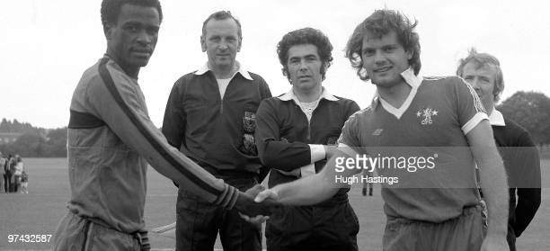 Chelsea captain Ray Wilkins shakes hands with the Malawi captain before the PreSeason Friendly match between Chelsea and the Malawi XI held on August...