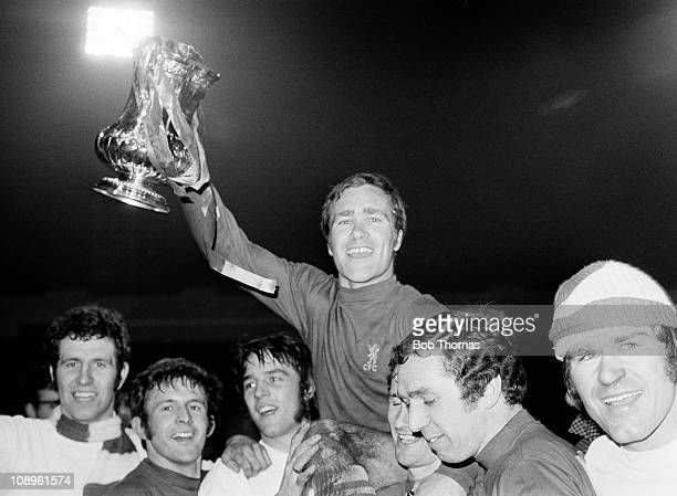 Chelsea captain Ron Harris celebrates with the trophy as he is lifted up by teammates left to right Peter Osgood John Hollins Ian Hutchinson Peter...
