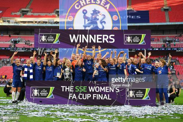 Chelsea celebrate victory following the SSE Women's FA Cup Final match between Arsenal Women and Chelsea Ladies at Wembley Stadium on May 5 2018 in...