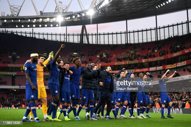Chelsea celebrate victory with their fans during the Premier League match between Arsenal FC and Chelsea FC at Emirates Stadium on December 29 2019...