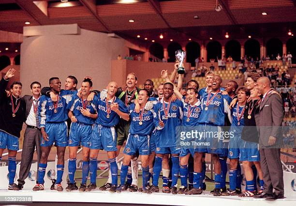 Chelsea celebrate with the trophy after their 10 victory over Real Madrid in the UEFA Super Cup Final played in Monaco 28th August 1998 Leftright...