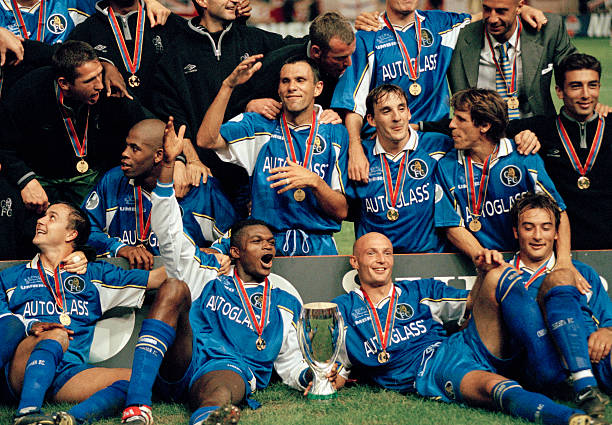 Chelsea celebrate with the trophy after their victory over Real Madrid in the UEFA Super Cup Final in Monaco, 28th August 1998. Chelsea won 1-0....