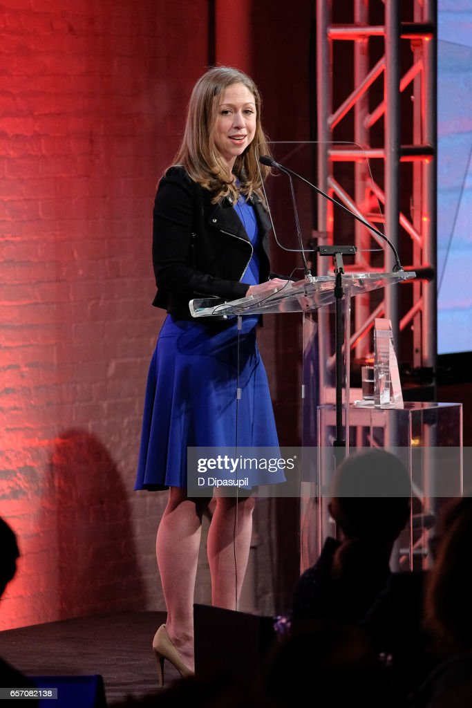 Chelsea Clinton accepts an award on behalf of her father, former US president Bill Clinton, during the GMHC 35th Anniversary Spring Gala at Highline Stages on March 23, 2017 in New York City.