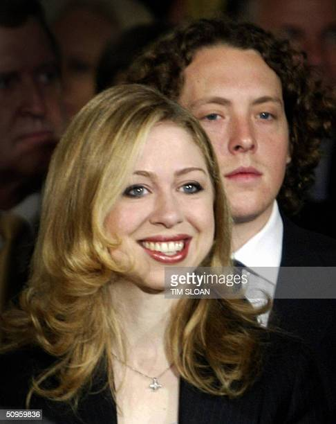 Chelsea Clinton and boyfriend Ian Klaus attend the unveiling of the official portraits of her father former US president Bill Clinton and mother US...