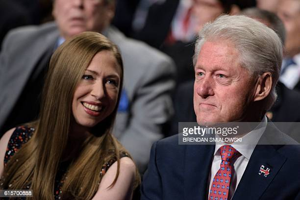 Chelsea Clinton and former US President Clinton wait for the final presidential debate between Republican presidential nominee Donald Trump and...