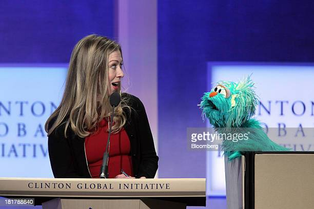Chelsea Clinton daughter of former US President Bill Clinton and Rosita Sesame Street muppet speak during the annual meeting of the Clinton Global...