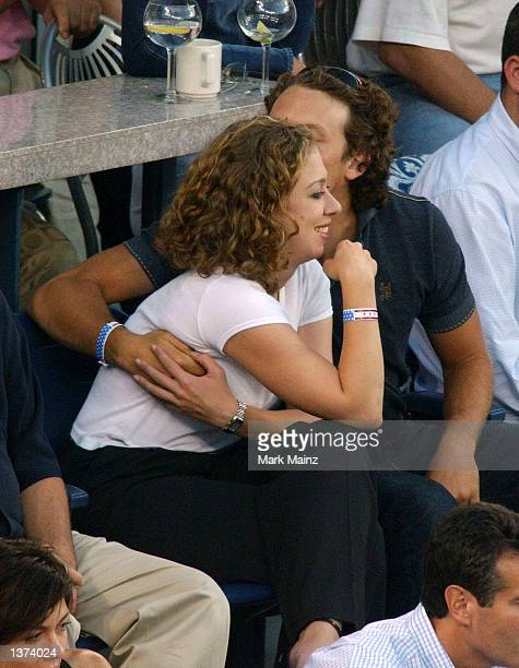 Chelsea Clinton gets a kiss from her boyfriend Ian Klaus during the 2002 US Open Mens Finals between Andre Agassi and Pete Sampras on September 8...