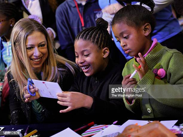 Chelsea Clinton joined Addison Rose and Auden Easter as they made handmade good wishes cards for children who are in the hospital in foster care or...