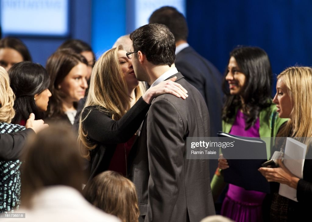 Chelsea Clinton kisses her husband Marc Mezvinsky during the Clinton Global Initiative (CGI) meeting on September 24, 2013 in New York City. Timed to coincide with the United Nations General Assembly, CGI brings together heads of state, CEOs, philanthropists and others to help find solutions to the world's major problems.