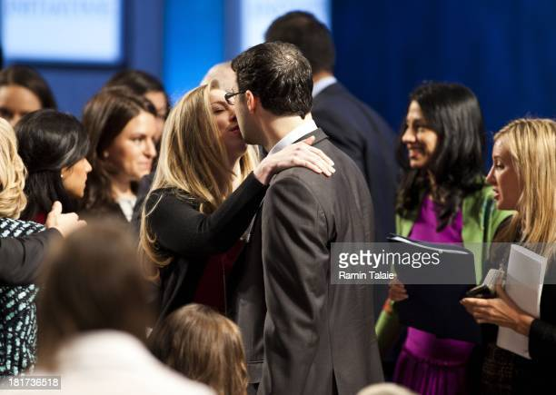 Chelsea Clinton kisses her husband Marc Mezvinsky during the Clinton Global Initiative meeting on September 24, 2013 in New York City. Timed to...