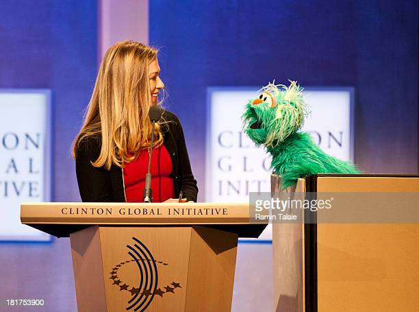 Chelsea Clinton speaks with Rosita the muppet from Sesame Street during the annual Clinton Global Initiative meeting on September 24 2013 in New York...