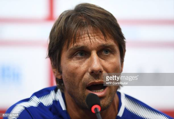 Chelsea coach Antonio Conte speaks at a press conference before a football training session in Beijing's National Stadium known as the Bird's Nest on...