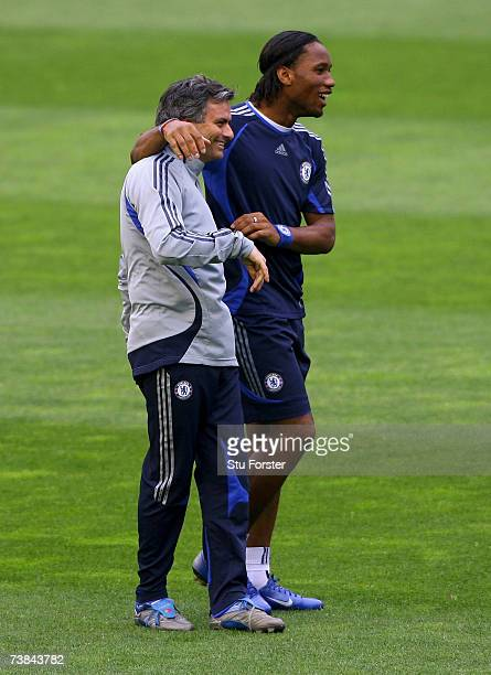 Chelsea Coach Jose Mourinho shares a joke with striker Didier Drogba during Chelsea training and press conference ahead of tomorrow's Champions...