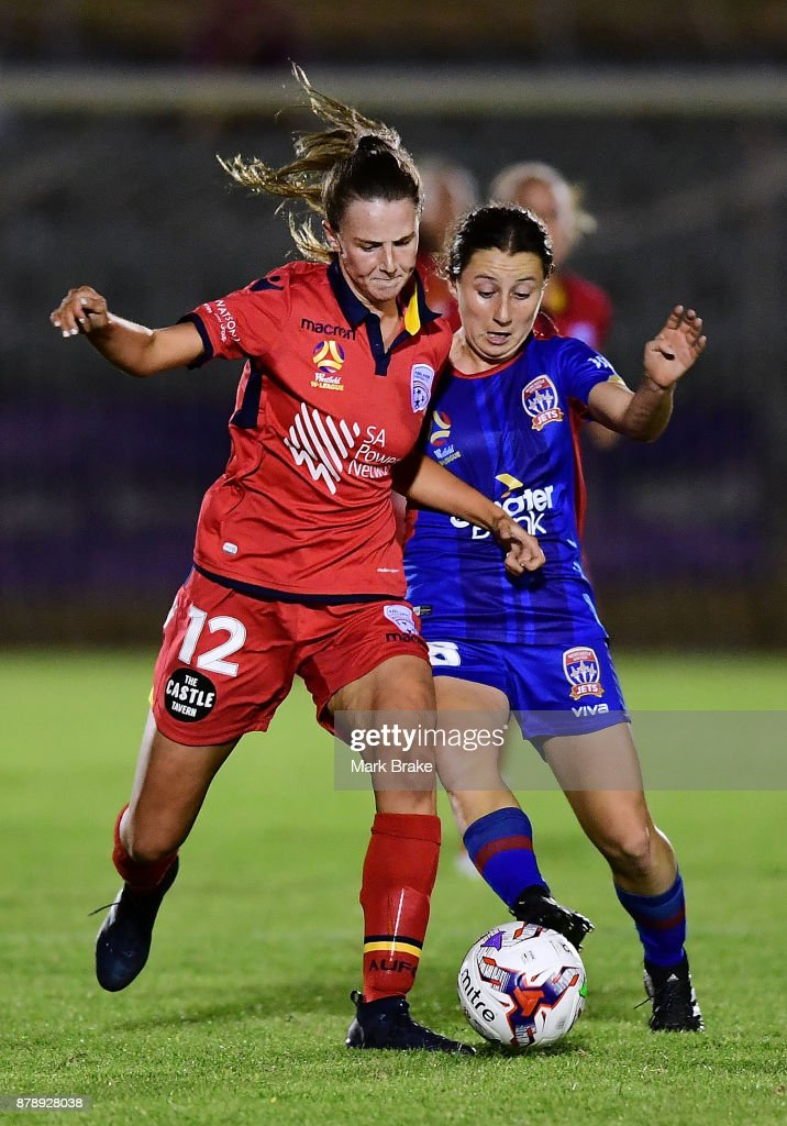 Chelsea Dawber of Adelaide United and Clare Huster of Newcastle Jets during the round five W-League match between Adelaide United and Newcastle Jets at Marden Sports Complex on November 25, 2017 in Adelaide, Australia.