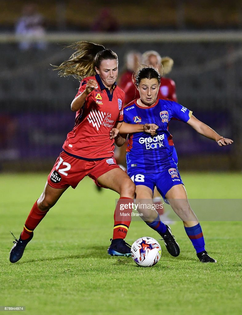 Chelsea Dawber of Adelaide United competes with Clare Huster of Newcastle Jets during the round five W-League match between Adelaide United and Newcastle Jets at Marden Sports Complex on November 25, 2017 in Adelaide, Australia.
