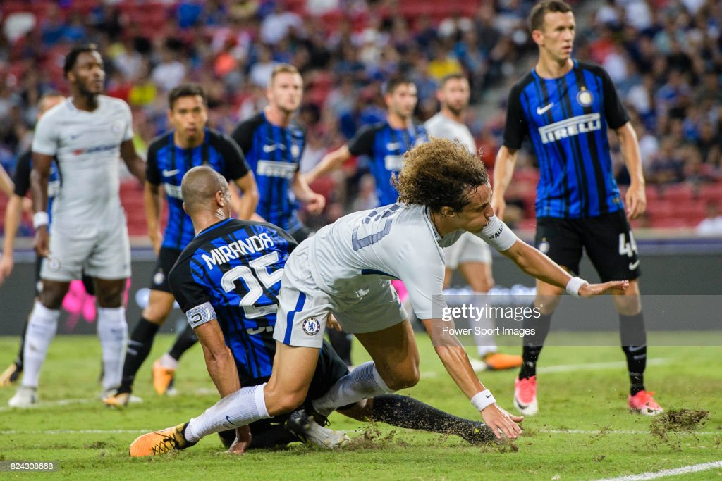 Chelsea Defender David Luiz (R) fights for the ball with FC Internazionale Defender Joao Miranda (L) during the International Champions Cup 2017 match between FC Internazionale and Chelsea FC on July 29, 2017 in Singapore.