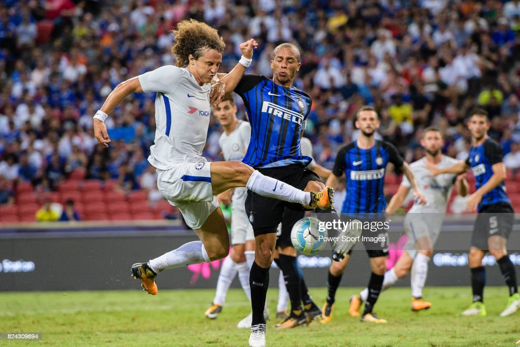 Chelsea Defender David Luiz (L) fights for the ball with FC Internazionale Defender Joao Miranda (R) during the International Champions Cup 2017 match between FC Internazionale and Chelsea FC on July 29, 2017 in Singapore.