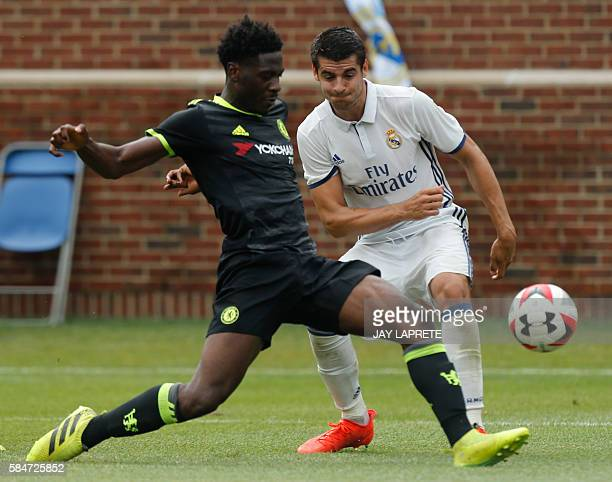 Chelsea defender Ola Aina kicks the ball past Real Madrid forward Alvaro Borja Morata Martin during an International Champions Cup soccer match in...