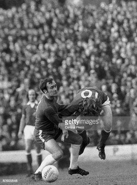Chelsea defender Ron Harris fouls Stan Bowles of Queens Park Rangers during a match at at Stamford Bridge London 23rd February 1974