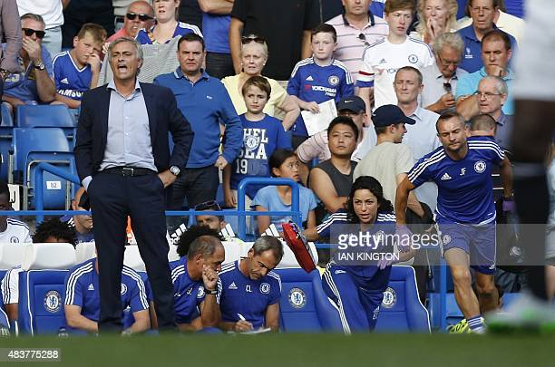 Chelsea doctor Eva Carneiro and head physio Jon Fearn leave the bench to treat Chelsea's Belgian midfielder Eden Hazard late in the game as Chelsea's...