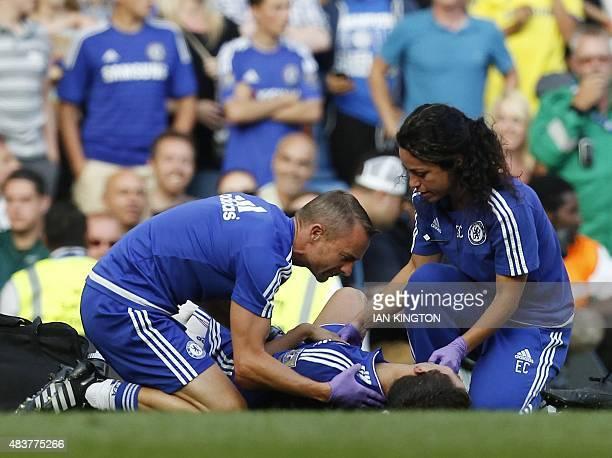 Chelsea doctor Eva Carneiro and head physio Jon Fearn treat Chelsea's Belgian midfielder Eden Hazard late on during the English Premier League...