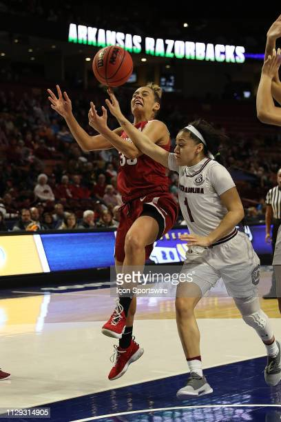 Chelsea Dungee guard of Arkansas is fouled by Bianca CuevasMoore guard of South Carolina as she takes a shot during the SEC Women's basketball...