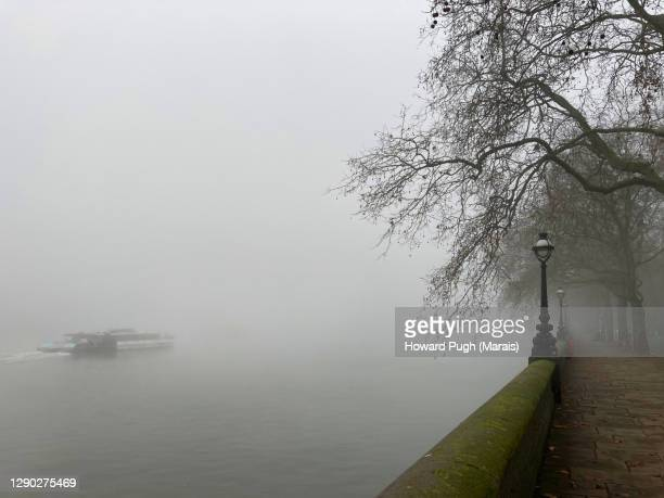 chelsea embankment misty morning - howard pugh stock pictures, royalty-free photos & images