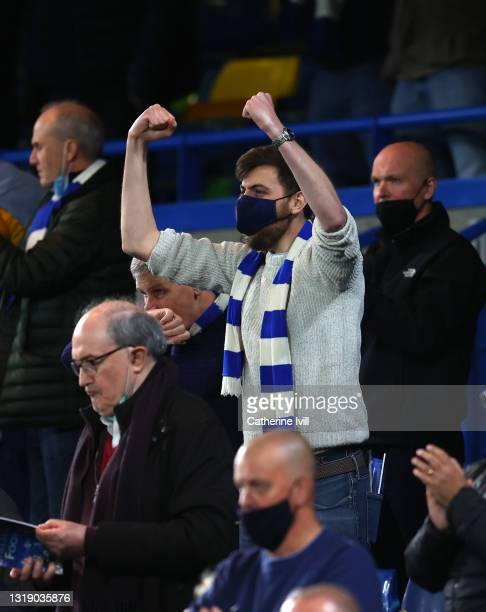 Chelsea fan celebrates during the Premier League match between Chelsea and Leicester City at Stamford Bridge on May 18, 2021 in London, England.
