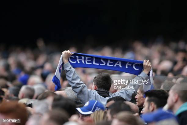 A Chelsea fan holds up a scarf in the crowd during the English Premier League football match between Chelsea and Tottenham Hotspur at Stamford Bridge...
