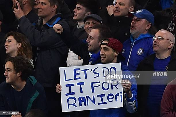 A Chelsea fan holds up a sign calling for his team to 'do it for Raneiri' during the English Premier League football match between Chelsea and...