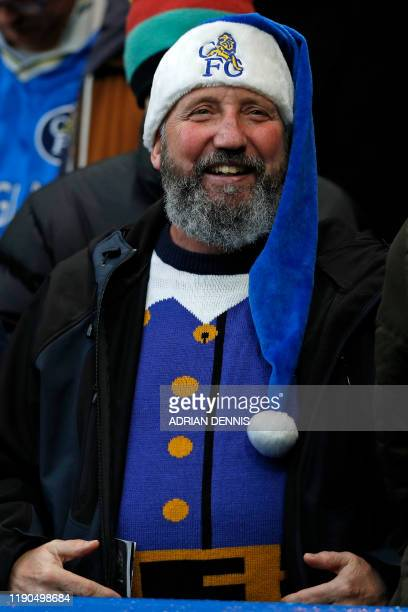 A Chelsea fan is festive gear awaits kick off in the English Premier League football match between Chelsea and Southampton at Stamford Bridge in...