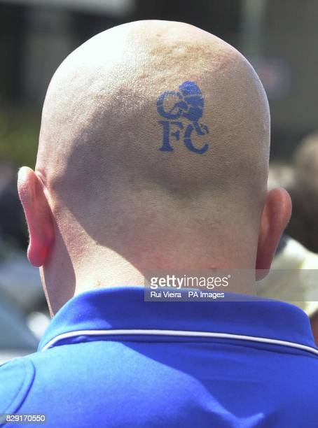 A Chelsea fan outside the Millennium Stadium in Cardiff sports his club's crest on the back of his head prior to kickoff of the Arsenal v Chelsea FA...