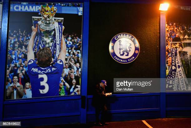Chelsea fan reads the match day programme outside the stadium prior to the UEFA Champions League group C match between Chelsea FC and AS Roma at...