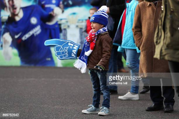 Chelsea fan waits outside the stadium prior to the Premier League match between Chelsea and Stoke City at Stamford Bridge on December 30 2017 in...