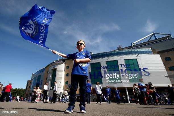 Chelsea fan waves a flag outside the stadium prior to the Premier League match between Chelsea and Everton at Stamford Bridge on August 27 2017 in...