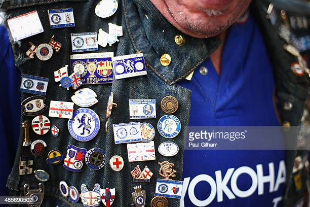 Chelsea fan with multiple pin badges ahead of the Barclays Premier League match between Chelsea and Crystal Palace on August 29 2015 in London United...