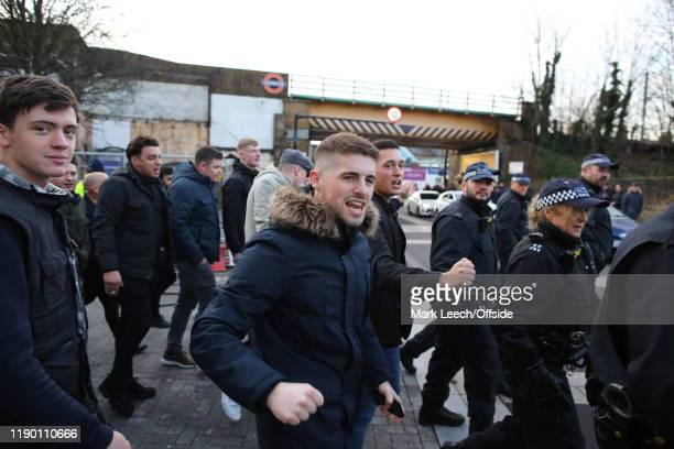 Chelsea fans are escorted from the railway station at White Hart Lane before the Premier League match between Tottenham Hotspur and Chelsea FC at...