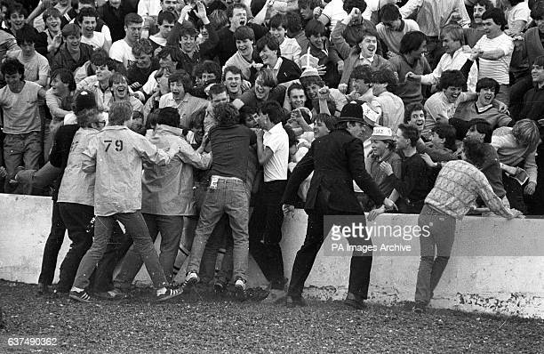 Chelsea fans celebrate after their team won promotion to Division One with a 50 victory over Leeds
