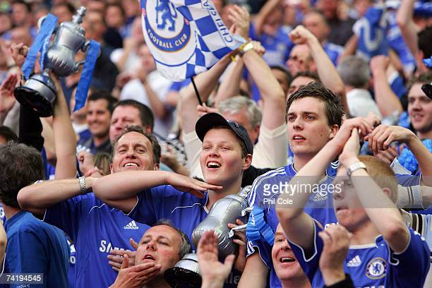 Chelsea fans celebrate following the FA Cup Final match sponsored by EON between Manchester United and Chelsea at Wembley Stadium on May 19 2007 in...