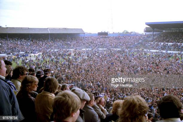 Chelsea fans celebrate promotion on the pitch after the Canon League Division Two match between Chelsea and Barnsley held on May 7 1984 at Stamford...