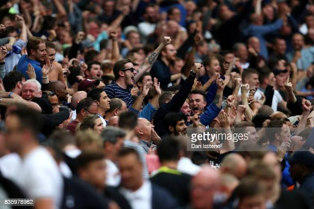 Chelsea fans celebrate victory as Tottenham Hotspur fans leave the stadium after the Premier League match between Tottenham Hotspur and Chelsea at...