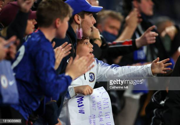 Chelsea fans cheer on their team during the Premier League match between Chelsea and Leicester City at Stamford Bridge on May 18, 2021 in London,...