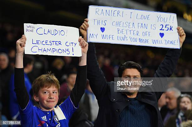 Chelsea fans hold up banners celebrating Leicester City being crowned champions following the 22 draw during the Barclays Premier League match...
