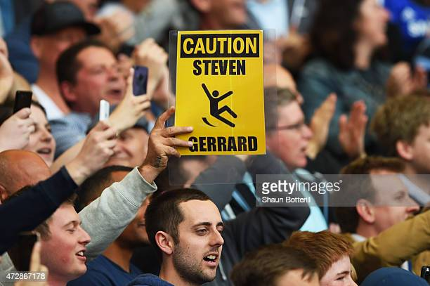 Chelsea fans hold up banners in reference to Steven Gerrard of Liverpool and his slipping over against their team last year during the Barclays...